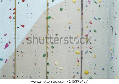 Climbing wall background with ropes and holds.