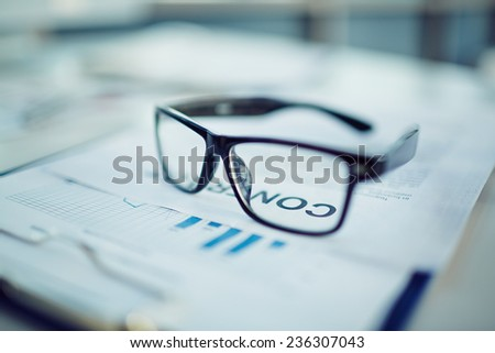 Clipboard with document and contract with eyeglasses on it
