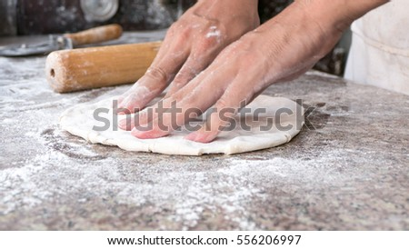 Close Chef making pizza, selective focus on front