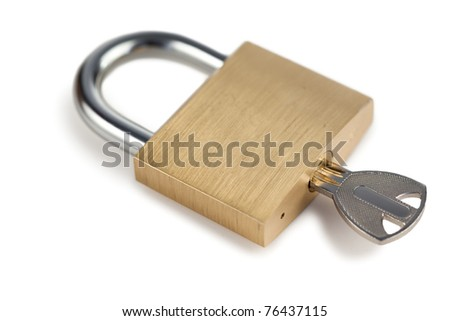 Close golden padlock on a white background