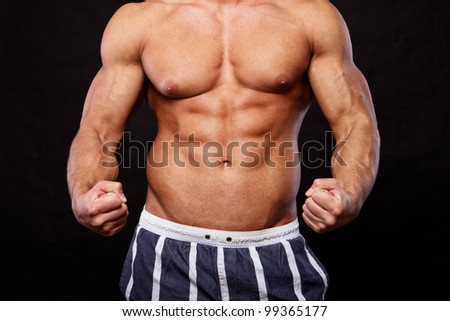 CLose image of muscle man posing