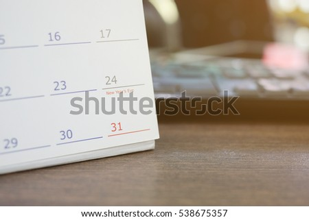 close up and soft focus on number 31 December of calendar on office desk:end of the year concept.schedule page paper for make important appointment:note meeting time:reminder or alert event:to do list