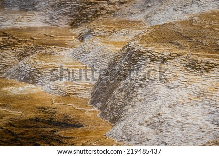 close up background of a mineral water flow leaving mineral deposits behind