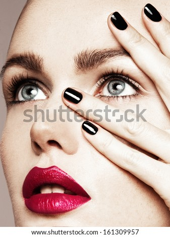 Close-up beauty portrait of beautiful model with bright make-up and manicure.