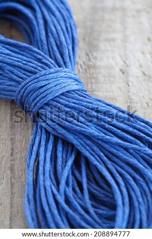 Close - up blue hemp ropes on wooden background