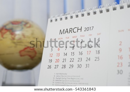 Close up calendar of March 2017 with blur earth globe background