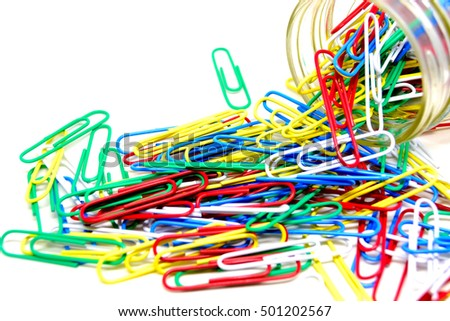 Close up colorful paper clips isolated on white background.