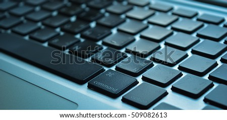 Close up computer laptop keyboard on desk with empty space technology blue background