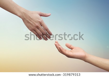 close up couple helping praying hand on blurred colorful heaven sky background.healing concept.medical faithful.compassion of human ideal conceptual.friendship and relationship of love affection.