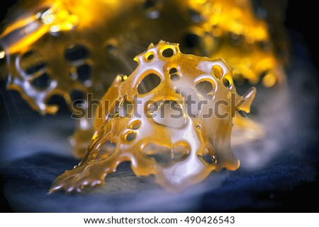 Close up detail of marijuana oil concentrate aka shatter