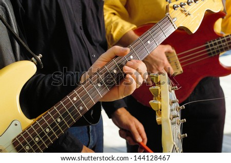 Close up detail of musicians hand on Electric Guitar