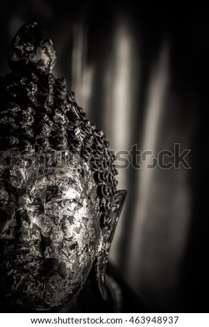 Close-up face Buddha statue,Thailand.Dramatic tone.