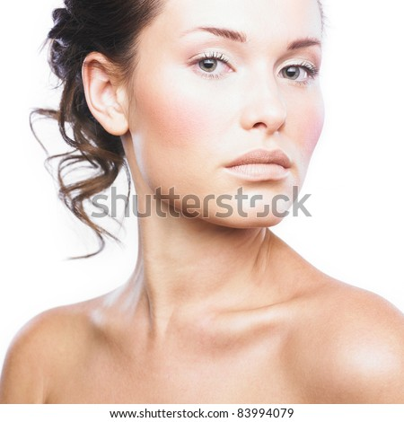 Close-up face of beautiful woman with clean fresh healthy skin. Isolated on white