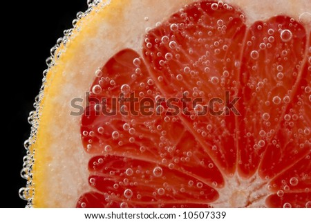 close-up fresh red grapefruit on black background