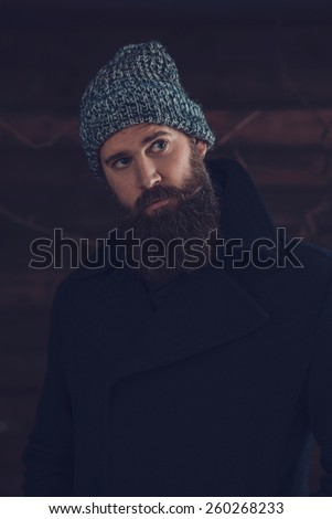 Close up Gorgeous Young Man with Long Beard, Wearing Winter Fashion Outfit, Looking Afar.