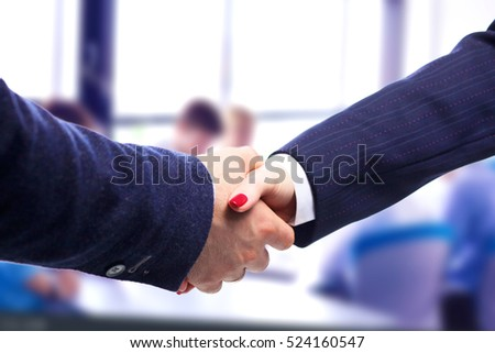 Close-up image of a firm handshake standing for  trusted partnership