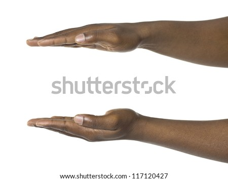 Close-up image of a human hand holding something against the white surface