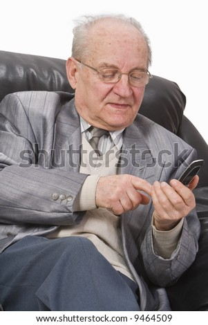 Close-up image of a senior man typing a message on his mobile phone.
