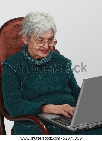 Close-up image of a senior woman using a laptop.