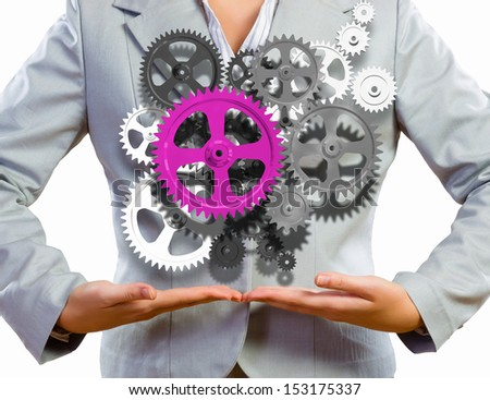 Close up image of businesswoman holding gears in hands