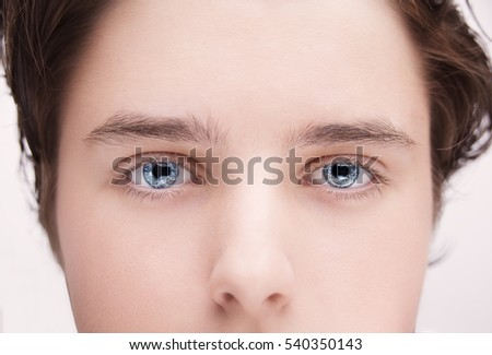 Close up image of insightful look blue human eyes