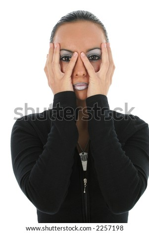 Close-up of a beautiful Bulgarian woman covering her face with her hands.