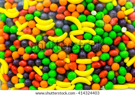 Close up of a bulk food container filled with colorful candy drops