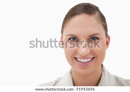 Close up of a businesswoman smiling at the camera against a white background