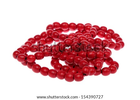 Close-up of a colorful bead necklace isolated on white background