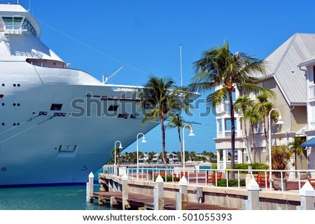Close up of a cruise ship docked in Key West, Florida, with Sunset Key in the background.