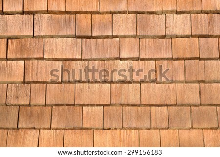Close-up of a facade made of brown shingles, taken in the Allgaeu in Bavaria, Germany.