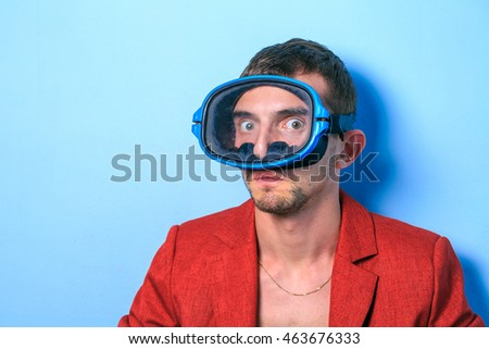 Close up of a funny young man in a red jacket  with different emotion. The collage of young man in a red jacket in a swimming mask with different emotion. emotional card.