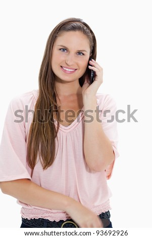 Close-up of a girl using a mobile against white background