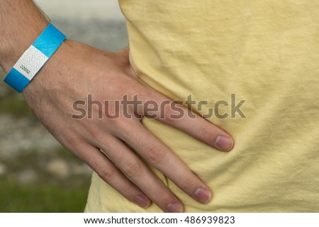 Close up of a hand with a blue paper activity wristband bracelet