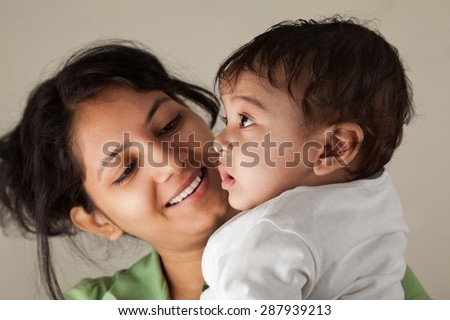 Close up of a Indian happy mother looking at her baby with love