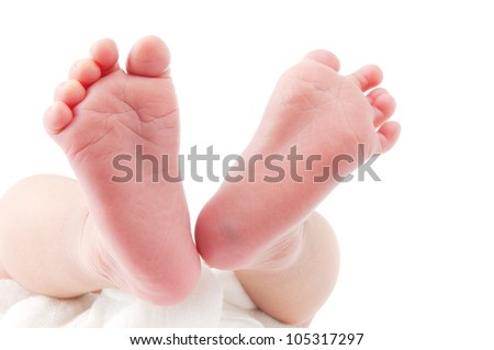 Close-up of a newborn baby feet over white background