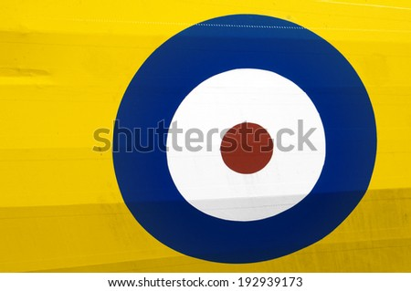 Close-up of a red, white, and blue Royal Air Force roundel on a yellow aircraft