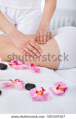 Close-up Of A Woman Getting Thigh Massage Treatment At Spa