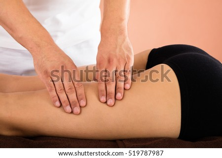 Close-up Of A Woman Receiving Leg Massage In Beauty Spa