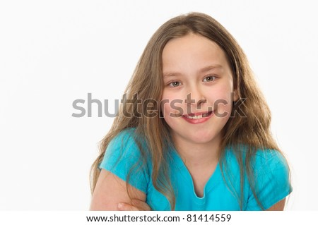 close-up of a 10 year old girl smiling at the camera