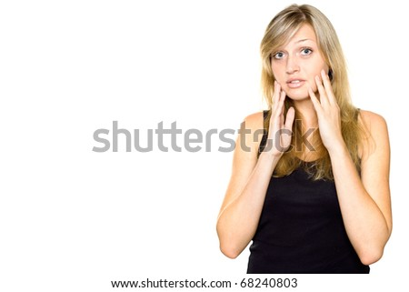 Close-up of a young woman looking surprised. Hands on cheeks. Lots of copyspace and room for text on this isolate