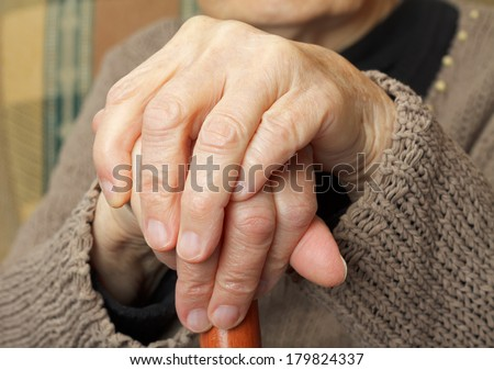 Close up of an elderly crossed hand