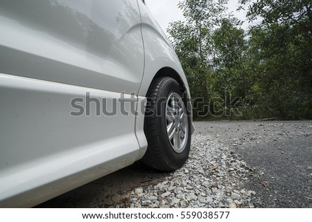 close up of at the side of a car and its tyre.