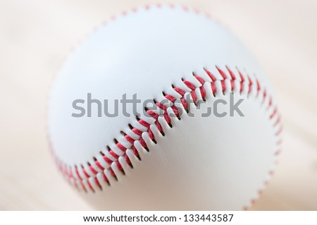 Close-up of baseball ball on wooden boards, studio shot