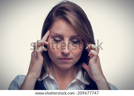 Close up of beautiful young businesswoman with headache over white background