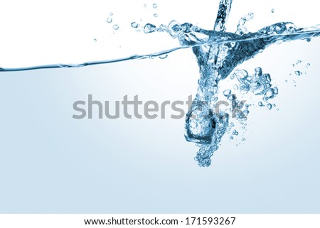 close up of bubbles in blue water