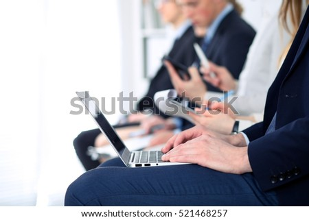 Close-up of business man hands typing on laptop computer at the conference