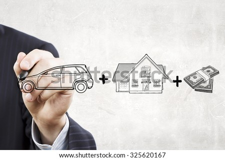 Close up of businessman drawing money concept