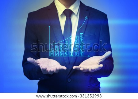 Close up of businessman holding graph in palms