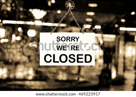 Close up of closed sign on shop door